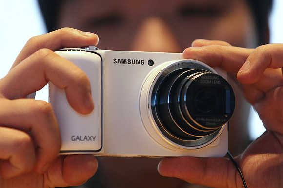 A visitor tries out Samsung Electronics' Galaxy Camera in Seoul.