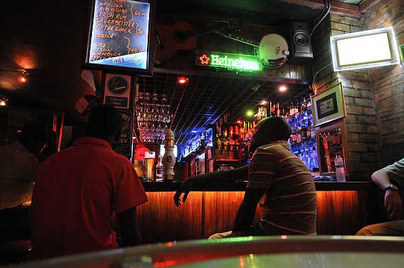 Patrons drink beer at a Maputo nightspot.