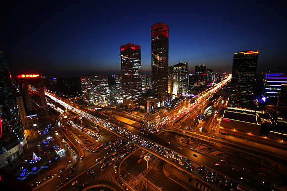 Vehicles drive on Three Ring Road and Jianwai Street in central Beijing.