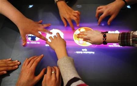 Students use a multi-touch computer in a digital classroom presentation in Hanover.