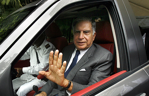 Ratan Tata leaves after addressing a news conference to announce the launch of Jaguar and Land Rover in India, in Mumbai.