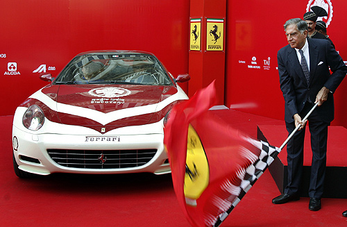 Ratan Tata flags off a Ferrari 612 Scaglietti on Magic India Discovery tour in Mumbai.
