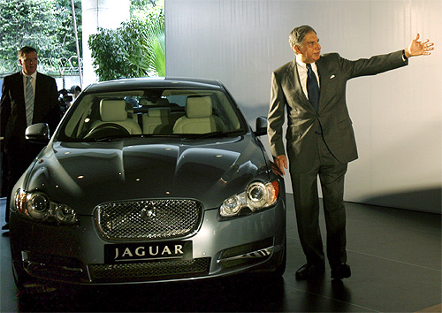 Ratan Tata stands next to a Jaguar XF in Mumbai.