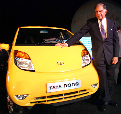 Ratan Tata stands alongside the Nano at its launch in Mumbai.