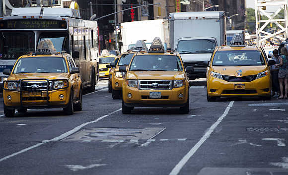 New York City taxis make their way through Times Square in New York.