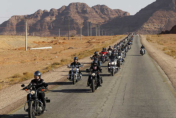 A convoy of 200 Harley-Davidson bikers ride through the desert in Wadi Rum in Jordan.