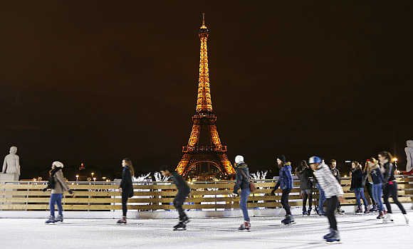 People skate on an artificial ice rink near the Eiffel Tower in Paris.