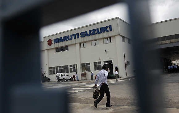 An employee walks inside Maruti Suzuki's plant at Manesar.