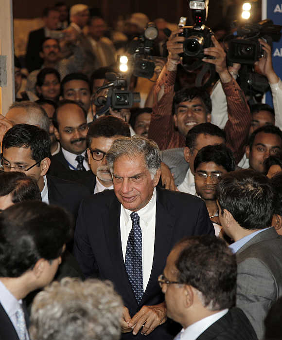 Ratan Tata, surrounded by the media, leaves the venue after receiving the life time achievement award for management conferred by the All India Management Association in New Delhi.