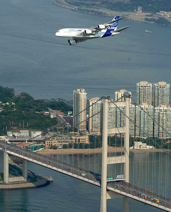 An Airbus A380 flies past the Tsing Ma Bridge in Hong Kong.