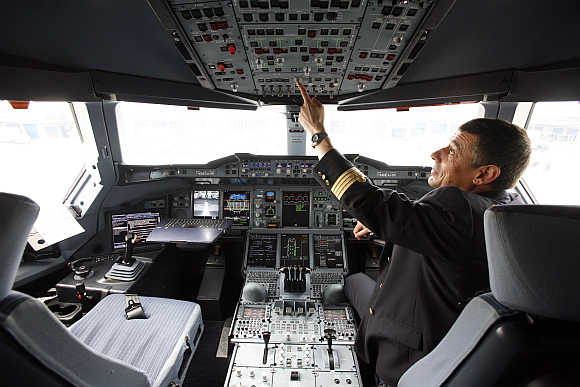 Test pilot Roy sits at the cockpit of the superjumbo in Shanghai.