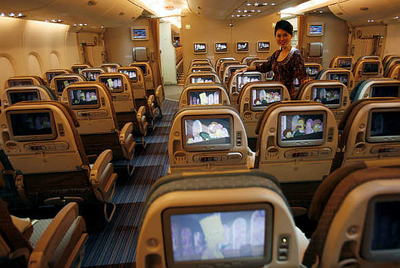 A stewardess in the Economy-Class cabin at Singapore's Changi Airport.