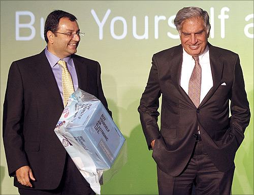 Tata Group Chairman Ratan Tata (R) and Deputy Chairman Cyrus Mistry attend the launch of a new website for tech superstore Croma, managed by Infiniti Retail, a part of the Tata Group, in