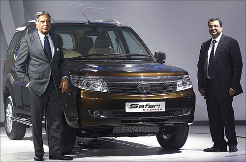 Tata Group Ratan Tata (L) and Tata Sons Deputy Chairman Cyrus Mistry pose with company's new SUV Safari-Storme during India's Auto Expo, in New Delhi.