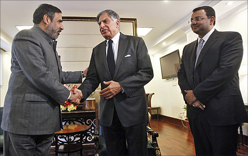 Trade Minister Anand Sharma (left) shakes hands with Ratan Tata as Cyrus Mistry looks on.