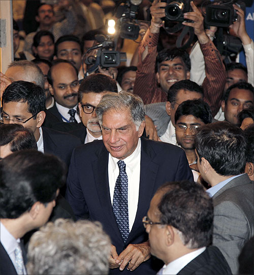 Ratan Tata (centre) leaves the venue after receiving the life time achievement award for management conferred by the All India Management