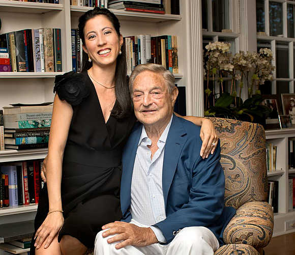 George Soros with his girlfriend Tamiko Bolton at Soros's residence in Southampton, New York.