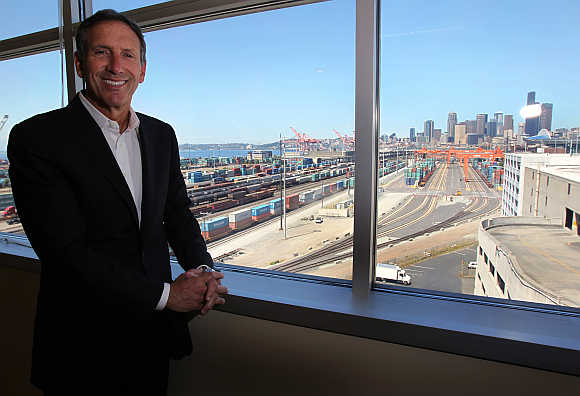 Starbucks CEO Howard Schultz stands in his office at his company's corporate headquarters in Seattle, Washington.