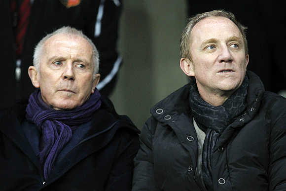 Francois, left, with his son Francois-Henri Pinault, right, in Rennes, France.