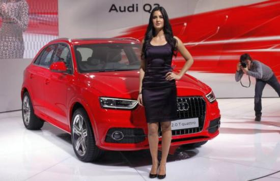 Bollywood actress Katrina Kaif poses with Audi's new SUV Q3 car during the India Auto Expo in New Delhi.