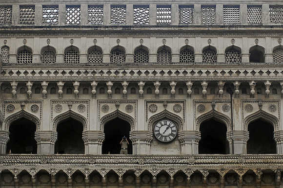 A security personnel watches through binoculars from Charminar in Hyderabad.