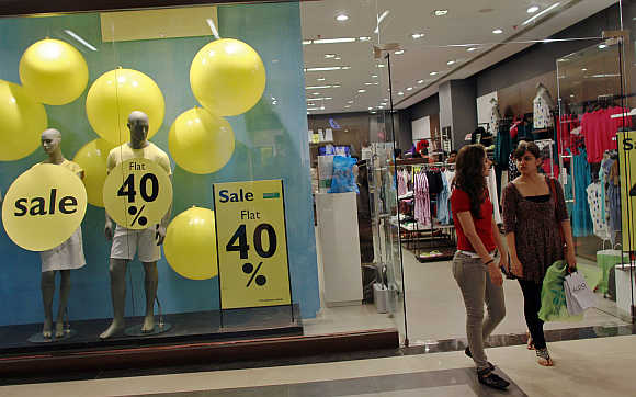 Shoppers exit a retail store inside a mall in Mumbai.