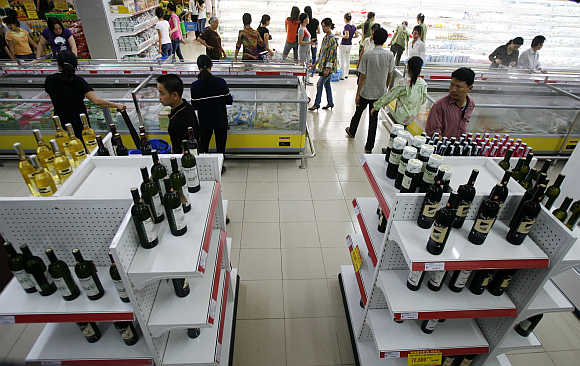 Wine bottles are displayed at a Saigon Coop supermarket in Hanoi, Vietnam.