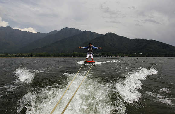 A tourist enjoys water skiing on the waters of Dal Lake in Srinagar.