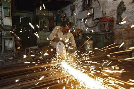 An employee works inside a metal workshop in Kolkata.