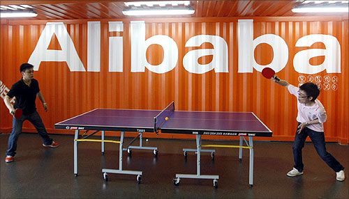 Employees play table tennis inside the headquarters office of Alibaba (China) Technology Co. Ltd on the outskirts of Hangzhou.