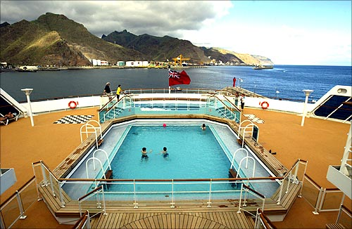 People take a swim in the pool of the Queen Mary 2.