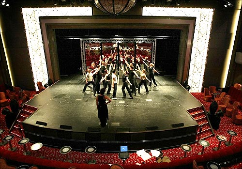 Dancers practice on the stage inside the theatre at the Queen Mary 2.
