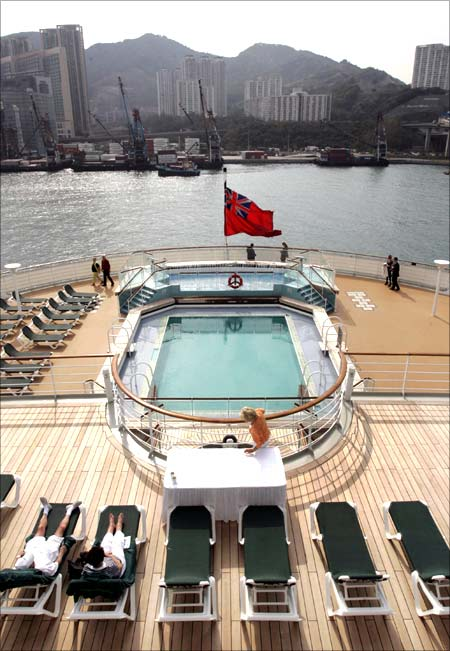Visitors sun bathe on the deck of the Queen Mary 2.