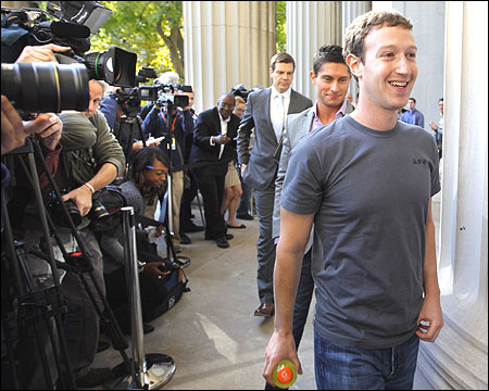 Facebook founder and CEO Mark Zuckerberg walks away after speaking to reporters.