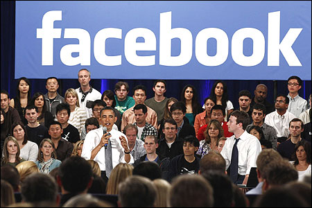 US President Barack Obama attends a town hall meeting with CEO Mark Zuckerberg.