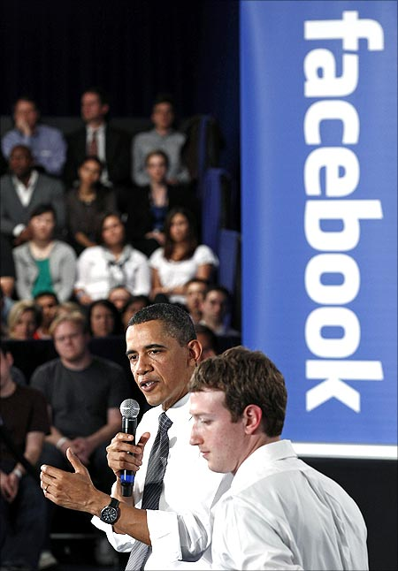 US President Barack Obama attends a town-hall meeting at Facebook headquarters with CEO Mark Zuckerberg in Palo Alto.