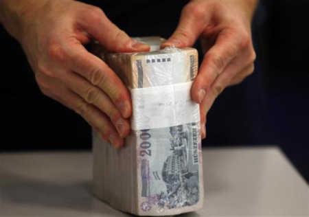 Banknotes undergo a quality check at the logistics centre.