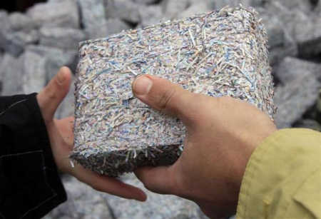 Banknotes shredded and compressed into heating fuel.