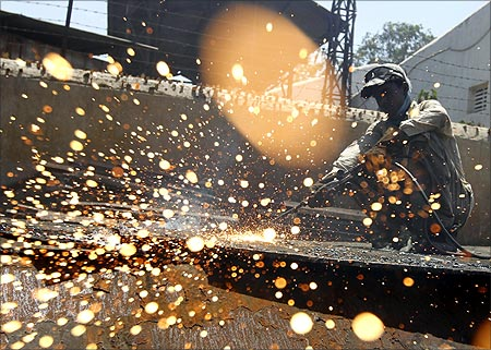 An employee works inside a steel rerolling mill at Chitra industrial area, on the outskirts of Bhavnagar town.