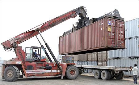 A container is loaded on a trailer truck at Thar Dry Port in Sanand.