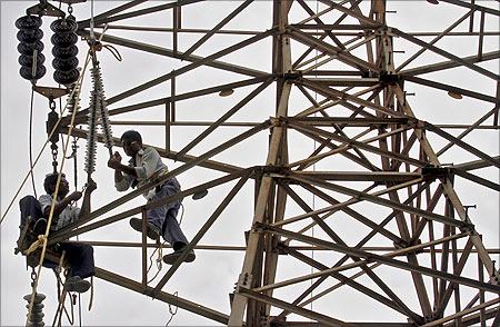 Employees of Gujarat Energy Transmission Corporation at work.