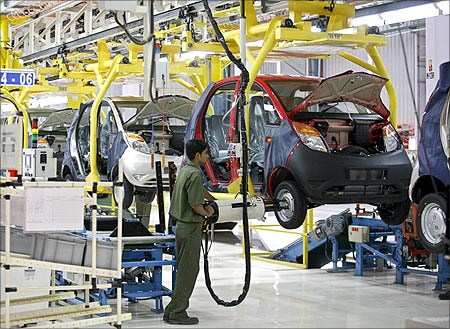 An employee works inside the newly inaugurated plant for the Tata Nano car at Sanand