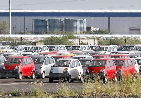 Tata Nano automobiles are seen parked at the carmaker's plant in Sanand.