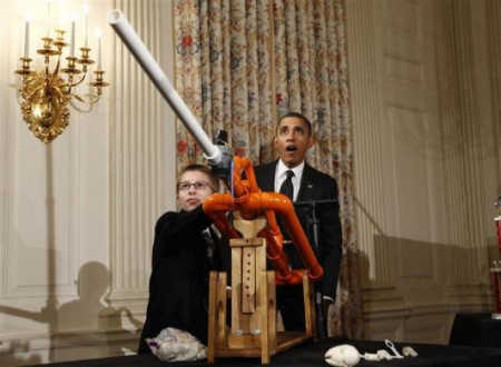 President Barack Obama reacts as Joey Hudy of Phoenix, Arizona, launches a marshmallow.