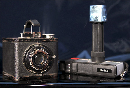 Two of Eastman Kodak's most successful cameras, a Brownie Special Six-20 (L), circa 1938-1942, which sold for $4, and the Pocket Instamatic 20 (R), which sold for about $28 in 1972.