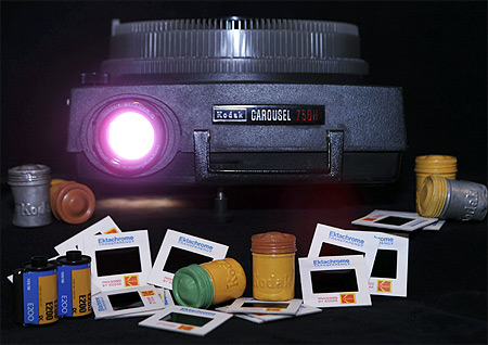 An Eastman Kodak Carousel slide projector, with 35mm color slide and film cannisters, are shown January 6, 2012 in this studio illustration in Washington.