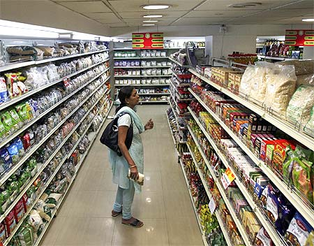 A customer looks at consumable goods before buying them at a supermarket in Hyderabad.