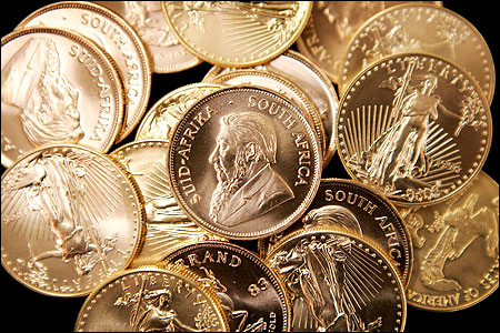 American Eagle and South African Krugerrand gold bullion is offered for sale at the Chicago Coin Company.