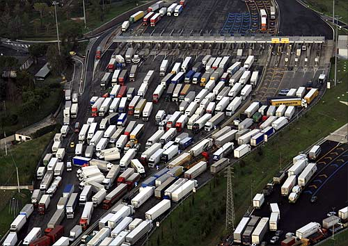 An aerial view of trucks in Italy.