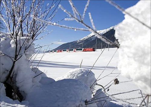 Glacier Express in the Goms valley at winter.